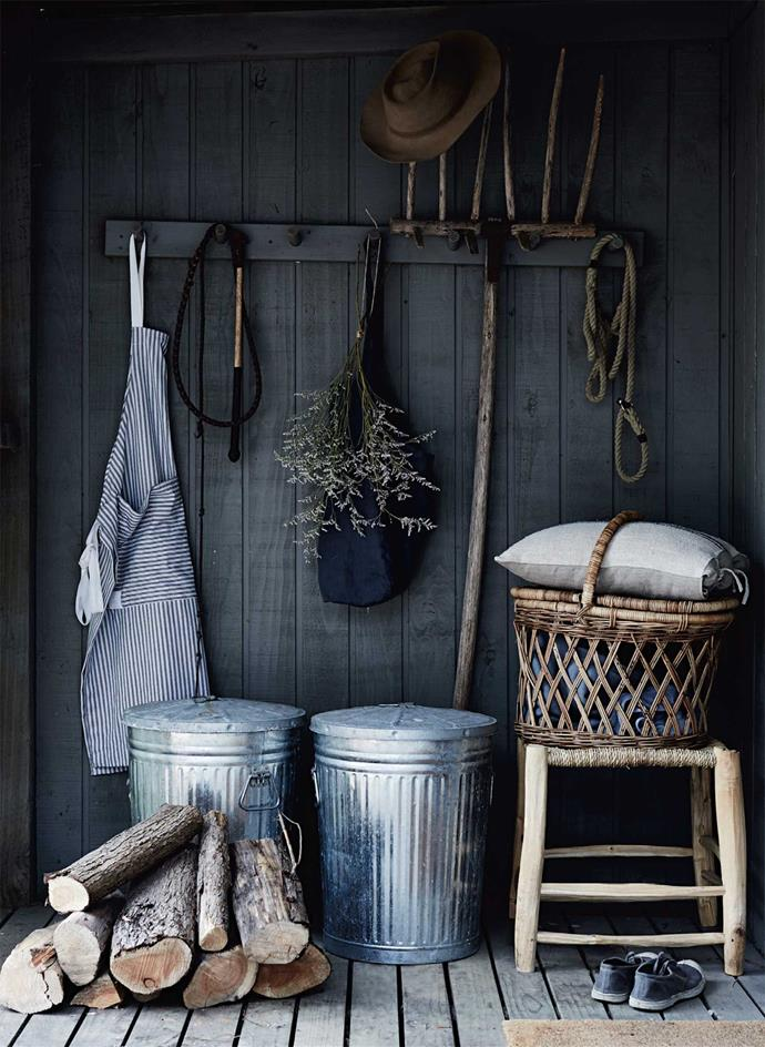 """At the back door, a rustic stool from Melbourne's [Turner & Lane](https://turnerlane.com.au/ target=""""_blank"""" rel=""""nofollow"""") serves as a good place to rest between relaxations."""