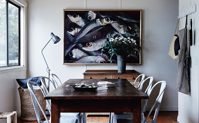 """Behind the early [19th-century farmhouse](https://www.homestolove.com.au/flower-farm-property-victoria-18945 target=""""_blank"""") table and the Xavier Pauchard Tolix Chairs hangs a heirloom painting that recalls the family's connection with aquaculture."""