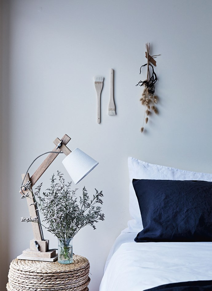 "Take a cue from the [farmhouse styling](https://www.homestolove.com.au/decorating-101-farmhouse-rustic-style-4345|target=""_blank"") and instead of giving everyday items the brush off, try turning them into wall art instead. The quirky touches are highlighted by the simple light and bed linen."