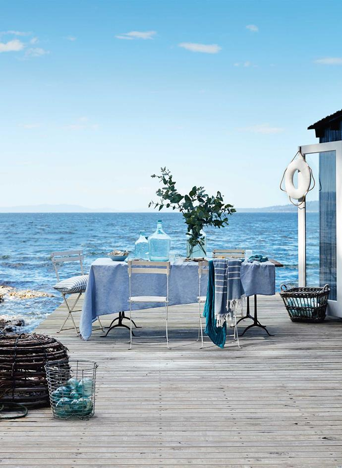 It's hard to be blue with this azure view. Setting the scene with a table, wire baskets, glass fishing floats and bottles all from The Drill Hall Emporium in New Norfolk. The Tasmanian mainland is just visible on the left.