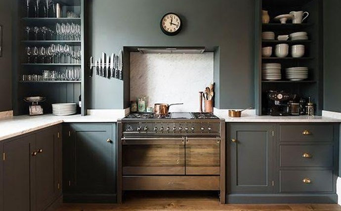 9. Moody Hues. Dark and dramatic kitchens are on the rise. Take cues from Devol Kitchens' latest hit: a moody room with deep cabinets, white marble, and copper accents.