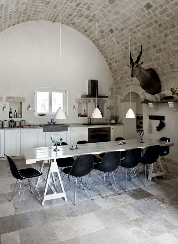 3. Unexpected furniture. Since the kitchen is the heart of the house and a room everyone spends a lot of time in, we're sprucing up the space with comfortable seating, antique (freestanding) cabinets, gorgeous lighting, art and even taxidermy. Photo by Jesper Ray and Pernille Kaalund for Truly Retreat Puglia.