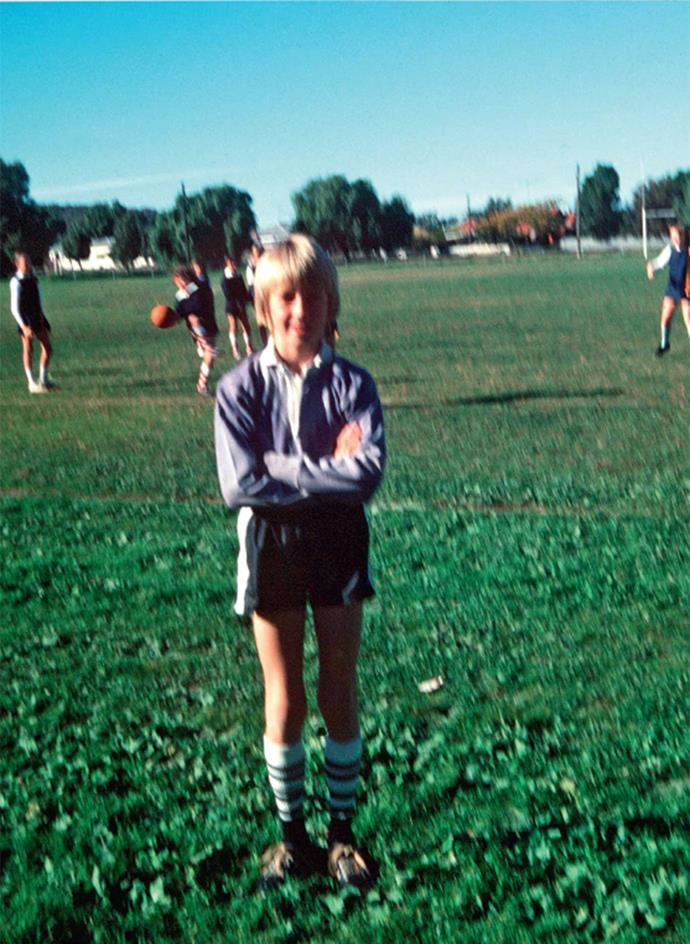 """Glenn on the footy field at nine years old. """"I was always very sporty and sport is often big in the bush,"""" he says. """"It's a way of bringing people together, whether it's cricket, golf or tennis."""" As a youngster, McGrath tried golf, basketball, football and then, of course, cricket."""