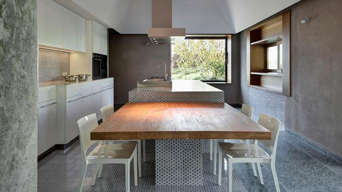 And the award for cleverest kitchen design goes to.... this guy! Simply move the chairs to the side when you're cooking up a storm for an industrial kitchen-sized prep area.  | Photo: Alamy