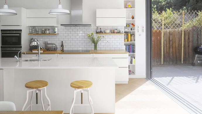 The subway tile splashback and industrial-style stools help give this island a lived-in, factory feel.    | Photo: Alamy