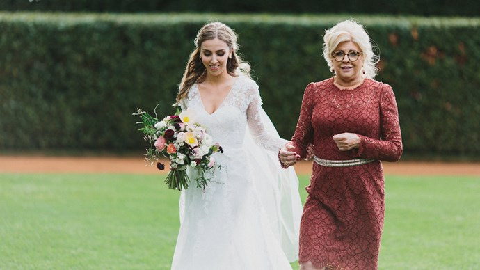 "Jessica's mum, Patricia, walked her down the aisle. ""My dad passed away eight years ago,"" says Jess. ""The night before the wedding, one of my bridesmaids gave me a flask of whiskey - Dad's favourite drink - and we drank a toast to him."" 