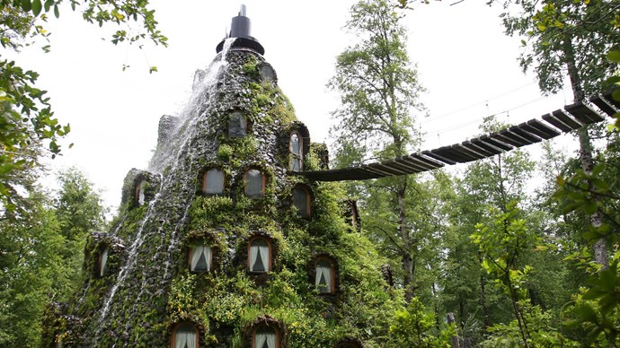 Montana Magica Lodge, Chile. This magical hotel is hidden away in the centre of a 300,000-acre private nature reserve and is only accessible by foot over a swinging rope bridge. Are you brave enough to try it?