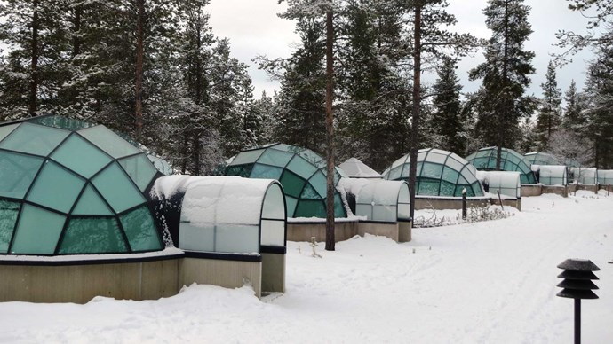 Hotel Kakslauttanen, Finland. Get super snuggly inside your very own glass igloo. Special thermal glass keeps the temperature inside the igloo at normal level and prevents the glass from becoming frosted so it's the perfect spot to admire the northern lights and sky full of stars.