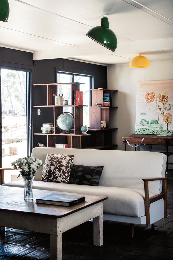 Laura had the sofa, which belonged to Rowan's grandmother, re-covered. The open-plan living, dining and kitchen area has been adorned with a mix of vintage finds and curios, largely from op shops.