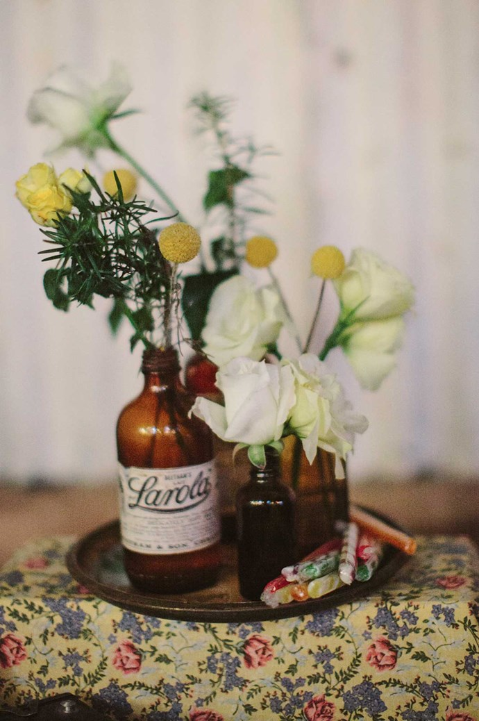 Flowers gathered in vintage jars decorated the tables. | Photo: Narelle Joy