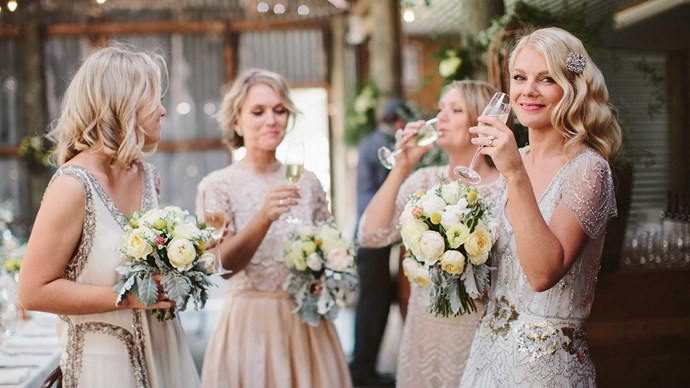 Elizabeth's three sisters were bridesmaids, each wearing a different dress.  | Photo: Narelle Joy