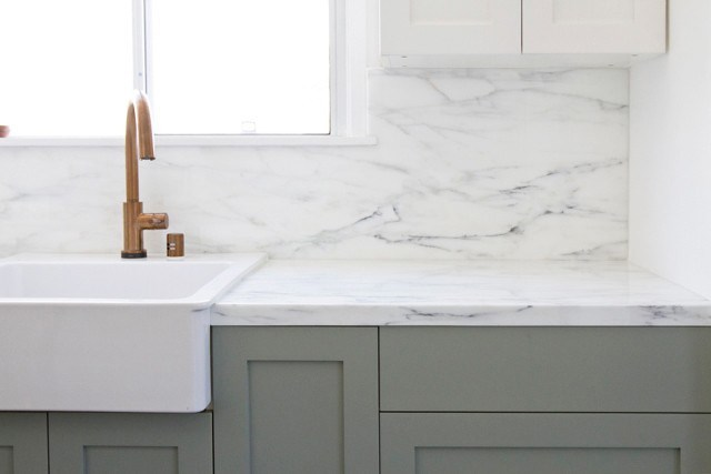 If you're worried about the weight of big, thick edges on your stone benchtops, bear in mind that the rest of the slab is usually cut thinner. In terms of finishes, marble is still the most popular option for most renovators - it's a classic that adds charm and character. When it comes to limestone, honed has lovely matt textures, onyx is sleek and can be backlit, and the reconstituted options have multiple benefits. Sarah Sherman Samuel's kitchen in LA features this counter and backsplash in Calacatta Gold marble and the butler's sink is from IKEA (the Domsjo; $299).