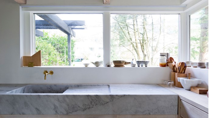 We love marble. It's a time-honored classic choice for benchtops, that is versatile enough to look good in all kinds of kitchens. But it's not without it's downsides: susceptible to staining, scratching, and etching, marble is a natural product that develops patina with use. Some of us love a surface that reflects our cooking history, others don't. This residence in Vancouver by Scott and Scott Architects uses a solid marble benchtop with integrated sink, weighing around 800 kilograms. Words and image editing by [Melissa Penfold](http://www.melissapenfold.com/).