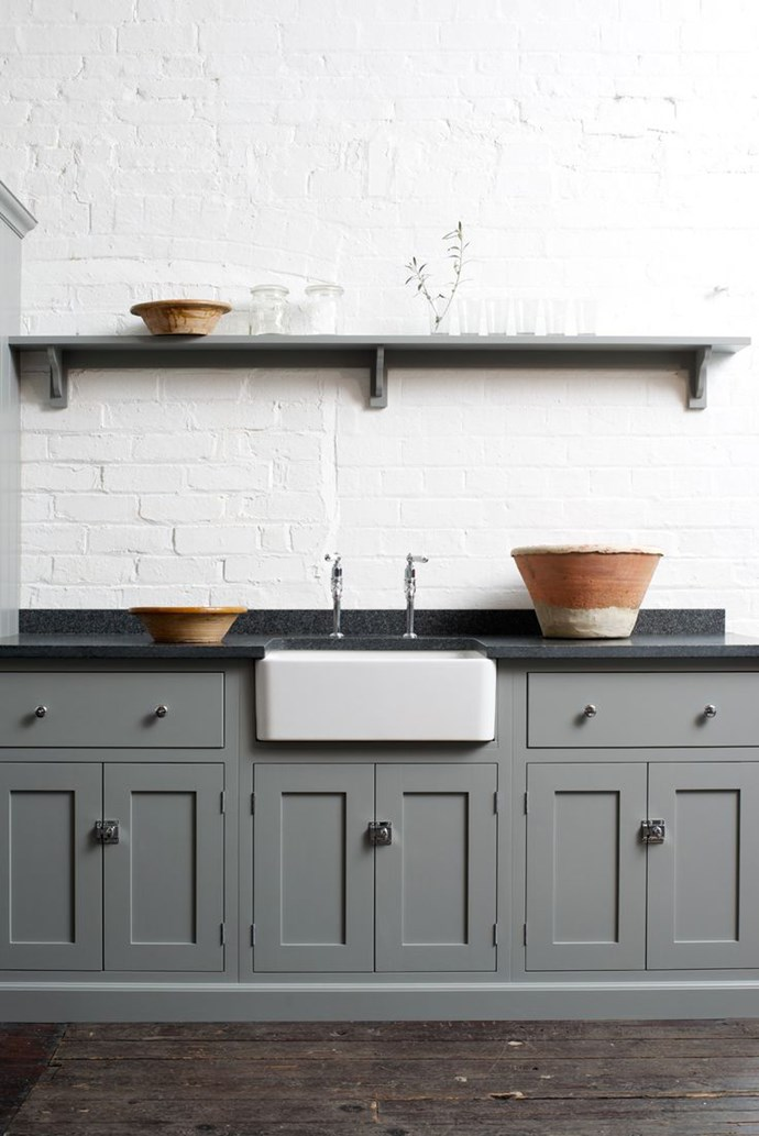 Consider toughness and heat resistance as well as looks when choosing kitchen benchtops: granite and marble can take a lot more knocks than limestone for instance. This kitchen by DeVol features classic yet modern black granite worktops. Photo by Sebastian Cox.