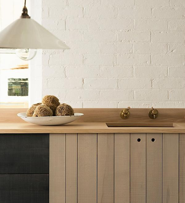 We love timber benchtops because they mix well with other materials, such as marble, and are easy on glassware and dishes (no noise when you put down a stack of plates). If maintained properly, timber is a long-lasting and durable choice that, unlike solid surface counters or laminate, can be repaired. This DeVol bespoke kitchen made from sustainable British timbers was photographed by Sebastian Cox