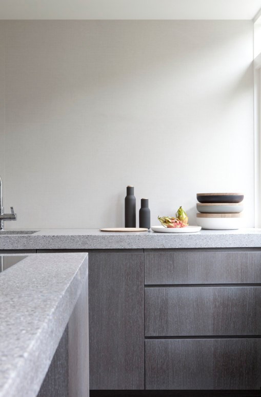 Concrete countertops have become a serious contender for those seeking a custom material with a natural sensibility. It comes in virtually any colour, finishes range from rough to smooth, and it will wear well with use.   Concrete kitchen by Vincent Van Duysen Architects.