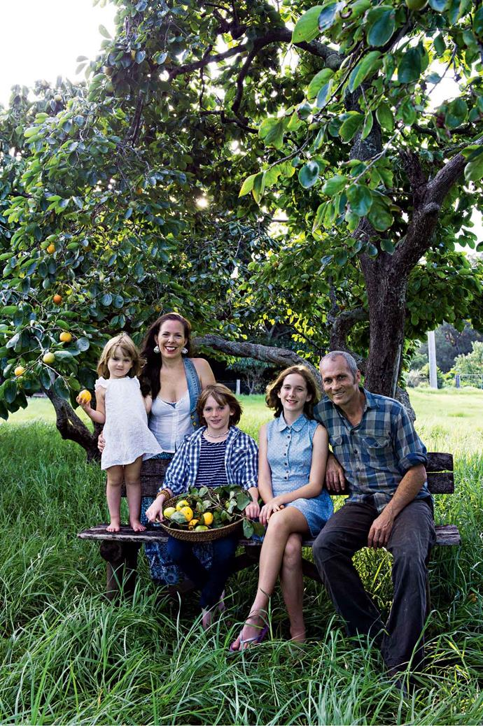 Amy (daughter of journalist Mike Willesee), Mark and the kids under one of the property's 100-year-old persimmon trees.