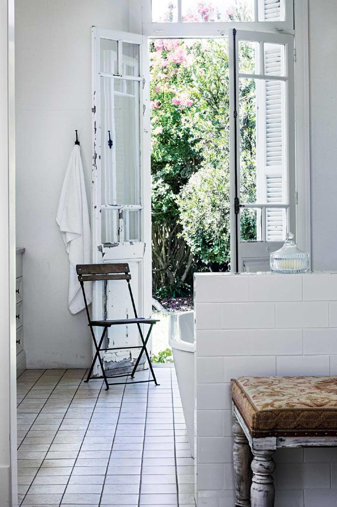 "The master ensuite features reclaimed [French doors](https://www.homestolove.com.au/how-to-choose-doors-and-windows-18928|target=""_blank"") opening onto the garden."
