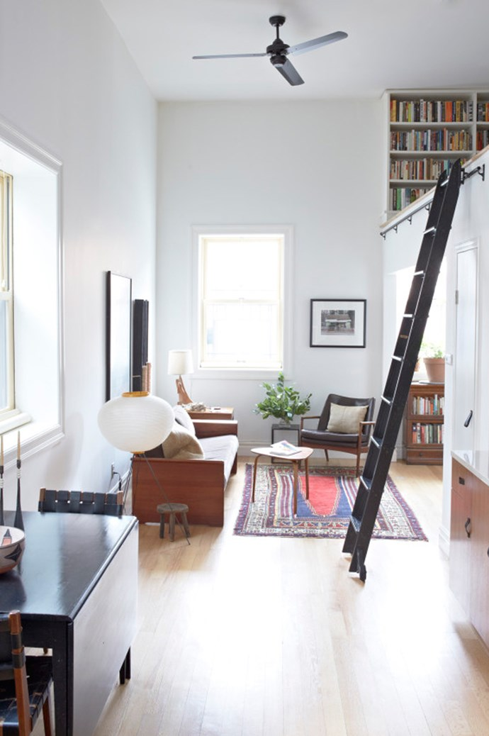 Nothing says 'small space style' like a New York loft apartment. In this home featured on [Cup of Jo](http://cupofjo.com/), the owners have made the most of up instead of across. A loft bedroom hovers above the living room alcove and a dining table and kitchen is tucked in neatly on the other side. Photography by [Alpha Smoot](http://www.alphasmoot.com/) and styling Kate Jordon.
