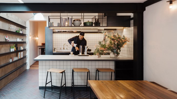 Tiny kitchens call for big style ideas. Here, [Breathe Architecture](http://www.breathe.com.au/) have cleverly employed a café-style scheme in simple monochrome. Open shelving above above the cook and prep zone keep essentials close to hand and along the wall storage and decoration come together in the form of elongated horizontal shelves. Photography by [Katherine Lu](http://katherinelu.com/).