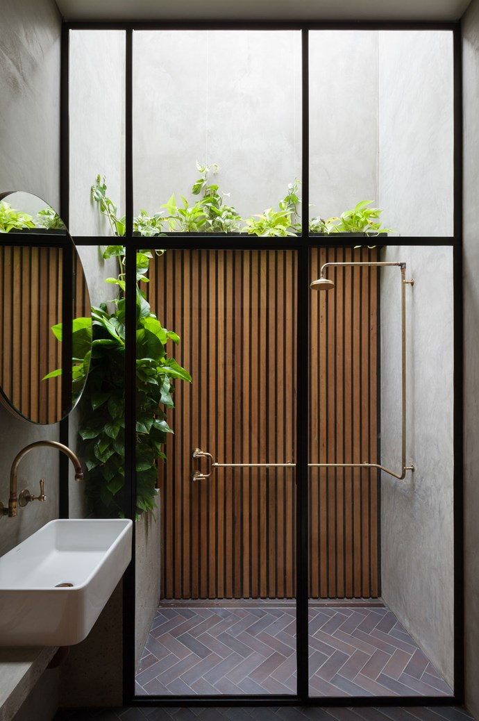 Linking to the outdoors always adds depth to small homes, and here in a tiny bathroom, an outdoor shower adds luxury and elegance to the space. Created by [Breathe Architecture](http://www.breathe.com.au/) the room cleverly utilises formerly wasted space and the touch of greenery brings vibrancy into the room that is also treated to life-enhancing natural light. Photography by [Katherine Lu](http://katherinelu.com/).