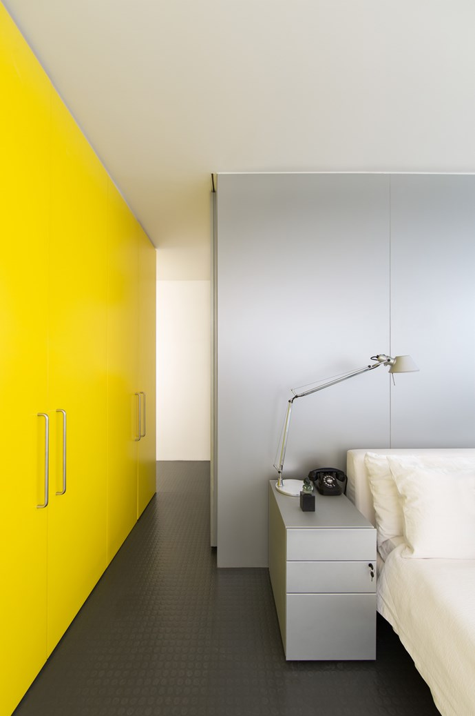 Up a level from the living zone, this bedroom created by the team at [Ian Moore Architects](http://ianmoorearchitects.com/) echoes the perky yellow built-in cupboards used below. Making a statement out of the oversized storage is a bold move that pays off in the style stakes and adds a bolt of colour to the small home. Photography by [Daniel Mayne](http://www.danielmayne.com.au/). Image from the [Australian Interior Design Awards](http://australianinteriordesignawards.com/)