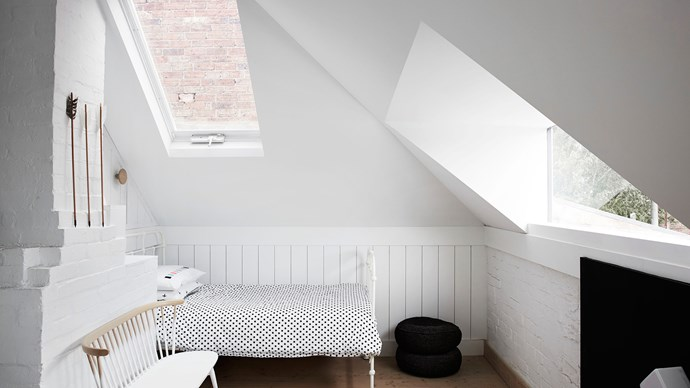 Attic spaces can feel expansive. [Whiting Architecture and Interiors](http://whitingarchitects.com/) united this space with a soft, dreamy white palette and then added voids in the ceiling to shower the space in light. All images supplied by the [Australian Interior Design Awards](http://australianinteriordesignawards.com/) | Photo: Sharyn Cairns