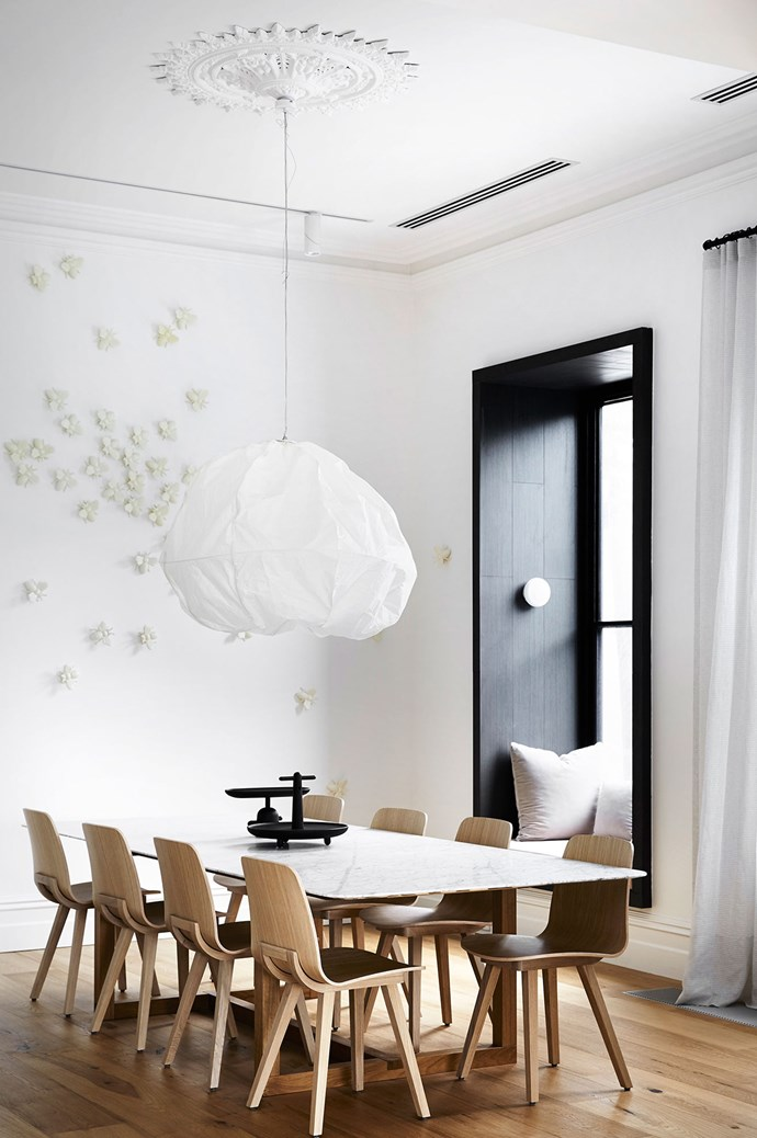 Pendant lighting will draw the eye upwards. In small rooms, enhance the sense of space with a lighting design that elongates the space. Here a beautiful pendant evokes a soft floating feeling, helping to balance a small dining space. Interiors by [Whiting Architecture and Interiors](http://whitingarchitects.com/). | Photo: Sharyn Cairns