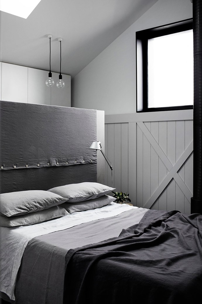Bedding can be used to highlight a mood. Small guest spaces are given a layer of luxury with simple yet beautiful bedlinen. Here, [Whiting Architecture and Interiors](http://whitingarchitects.com/) evoke a feeling of calmness and comfort by selecting a soft wash of grey in gentle tonal gradients. The headboard ties into the scheme with sophisticated style. | Photo: Sharyn Cairns