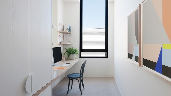 Home offices call for the clever use of cramped spaces. Joinery can help keep the room streamline and beautiful. Here [Nixon Tulloch Fortey](http://www.ntfarchitecture.com.au/) have placed a long black framed window to frame the view and lengthen the space. | Photo: Shannon McGrath