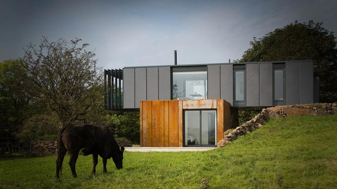 Designed by [Patrick Bradley Architects](http://www.pb-architects.com/), this award-winning home in Northern Ireland was simply constructed using four recycled shipping containers.