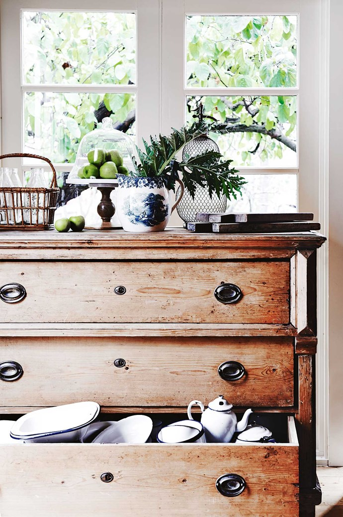 "The Red Store stocked new and [vintage provincial homewares](https://www.homestolove.com.au/french-provincial-style-10-key-elements-6741|target=""_blank""), like this enamelware spilling from a chest of drawers."