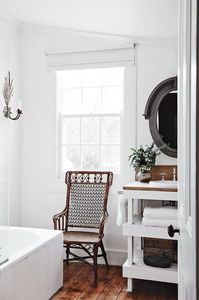 """A French mansard mirror hangs above the bathroom vanity. The white roller blinds, which match the shade of Dulux Opal White, were installed by [Elizabeth Hooper Furnishings](http://www.elizabethhooperfurnishings.com.au/