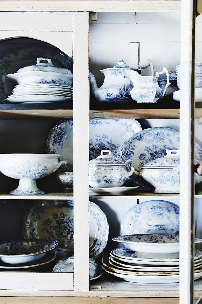 """Classic chinaware is displayed in a rustic white cupboard. Liz's celebrated philosophy of """"things you can still use and live with"""" imbues all her antiques with a sense of character."""