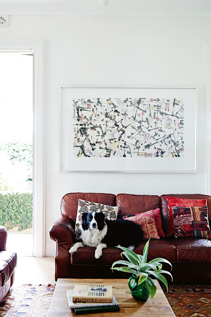 Walls that were once lime-green are now off-white, splashed with colour through  vibrant decor and contemporary artworks.