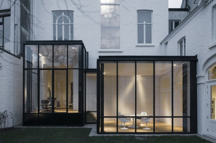 If your metal doors get direct sunlight, consider the glass and think about tinted or coated options. And for exterior doors, double-paned or low E (low emissivity) glass, which is coated with a heat-reflective material, is recommended for insulation. Designed by architect Hans Verstuyft.