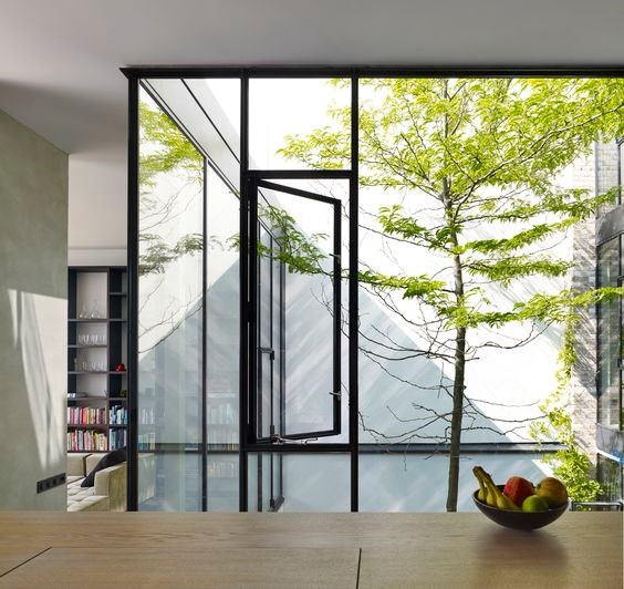 Metal doors can be hinged, sliding, louvred, (folding) or pivoted. All are good options, worth investigating. Inner light well, House in Rieteiland, NL, by Office Winhov.