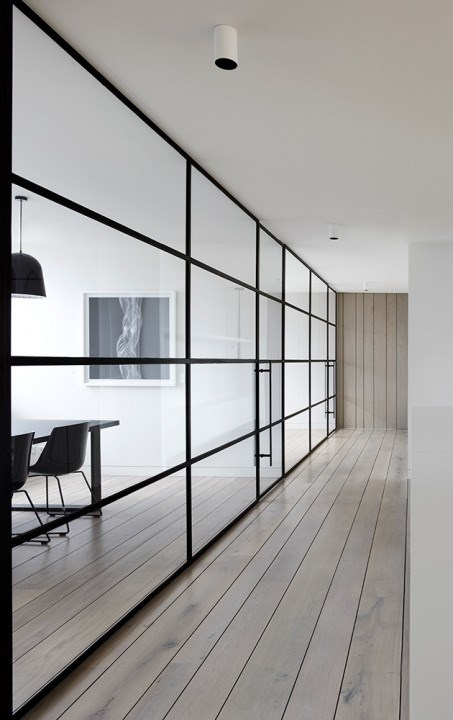 Lightweight steel-framed doors are great for filling wide interior openings and creating a sense of flow between rooms. Photography by Peter Clarke.