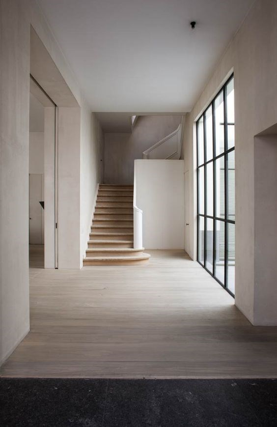 Expand the feeling of space with steel doors that open the back of your entire house.  Interior by Vincent Van Duysen.