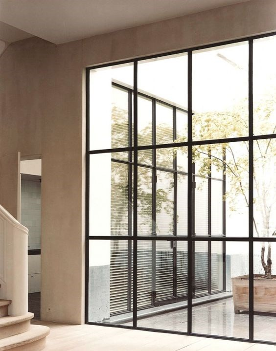 Steel doors and windows expand your outdoor living space by bringing the exterior in, and the interior out. Interior by Vincent Van Duysen.