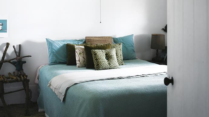 """""""You really don't need that much,"""" Cherie says. The home interiors are founded on a minimal palette of soothing blues and greens."""