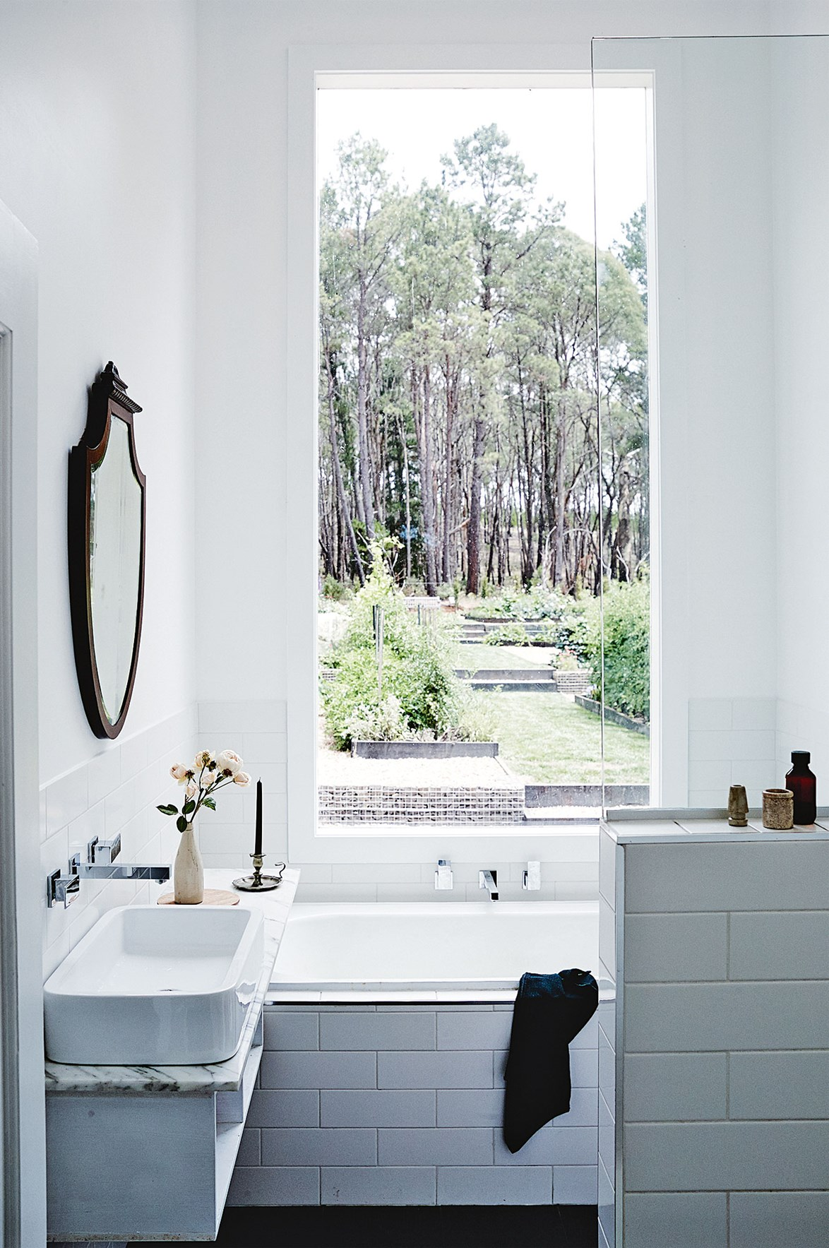 "With views of the verdant vegetable garden, the bathroom of this [French-inspired home in Spargo Creek](https://www.homestolove.com.au/french-inspired-country-home-in-spargo-creek-13750|target=""_blank""), Victoria, allows it's horticulturalist owners to wash of the day's dirt while admiring their work."