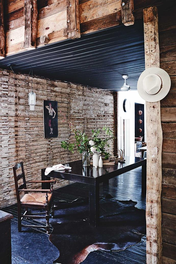 "The couple stripped back ""10 layers of wallpaper, hessian, plaster and masonite"" to reveal an early timber and earth wall imprinted with finger marks and covered in old strips of timber, known as battens. They kept the wall with all its imperfections, now a standout feature in the home."