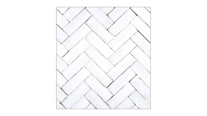 Traditional herringbone. The varying directions of the tiles can make a small room appear larger.