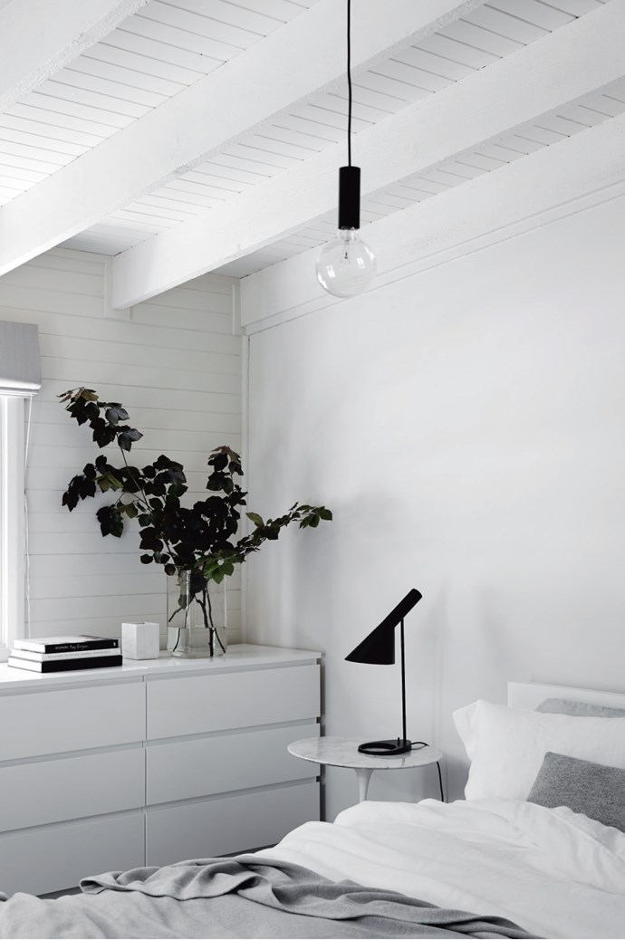 "The bedroom upholds the simple, [monochrome aesthetic](https://www.homestolove.com.au/how-to-master-a-monochrome-decor-scheme-5867|target=""_blank""), with black accents complementing white paint and furniture."