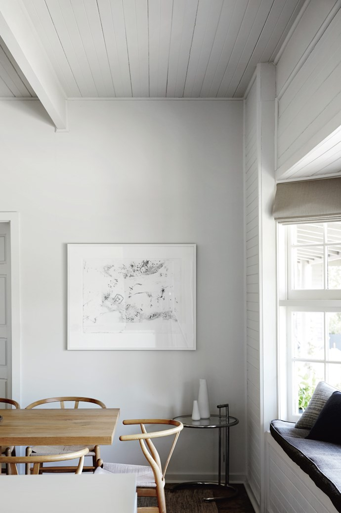 """Where I see decoration is in artworks,"" says Annabel. Her collection fans outwards in a monochromatic spectrum, from black-and-white photographs and drawings to this monoprint in the dining room by John Wolseley."