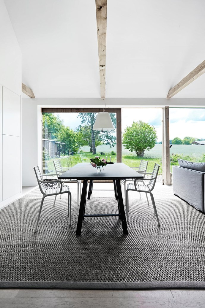 """'Pip E' dining chairs by Phillipe Starck for Driade surround a simple trestle table. """"Having windows on just one side of the house is actually comforting — it's like you're in a cosy little box."""" 