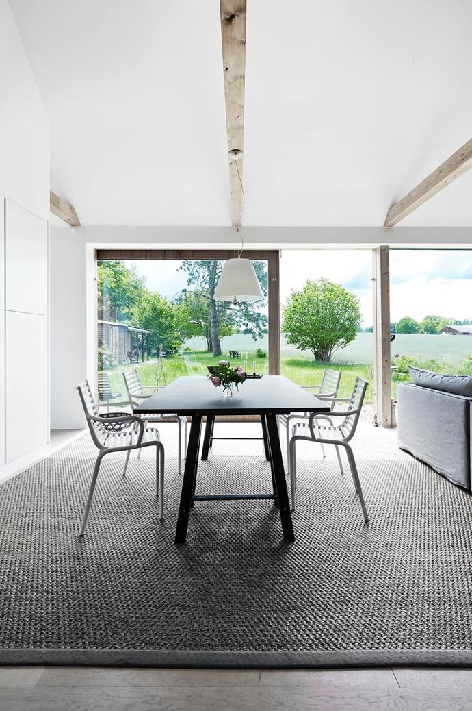 "'Pip E' dining chairs by Phillipe Starck for Driade surround a simple trestle table. ""Having windows on just one side of the house is actually comforting — it's like you're in a cosy little box."""