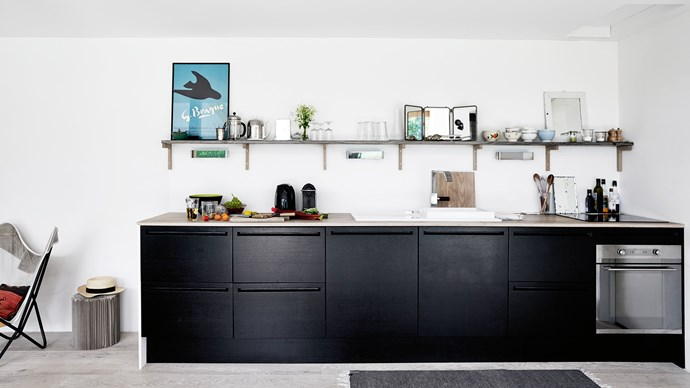 The kitchen from Hamburg's The Box is finished in stained oak. Hélène writes cook books, as well as working as a journalist and children's author. | Photo: Birgitta Wolfgang Drejer/Sister Agency