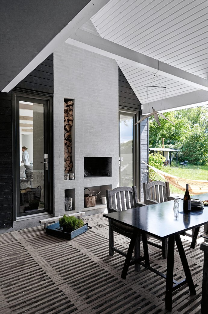 The porch is a vital part of the house design. A door that slides back into the roof can open the porch to the elements or shield it in less than ideal Danish weather. | Photo: Birgitta Wolfgang Drejer/Sister Agency